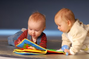 bigstockphoto_babies_playing_with_toys_2666254_92r7